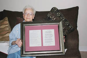 Photo -  Nancy Davis holds a poem her husband of 57 years wrote for her. The poem survived the May 20 tornado that ravaged Moore and destroyed her house. Photo by Jocelyn Pedersen, for The Oklahoman  <strong>Jocelyn Pedersen</strong>
