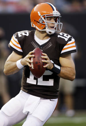 Photo -   Cleveland Browns quarterback Colt McCoy drops back to pass in the first quarter of a preseason NFL football game against the Chicago Bears, Thursday, Aug. 30, 2012, in Cleveland. (AP Photo/Mark Duncan)