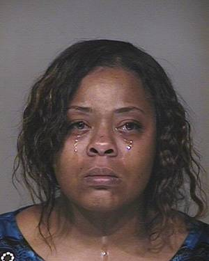 Photo - This photo provided by Scottsdale police, Shanesha Taylor is shown.  Taylor, 35,  had an important job interview last month at an insurance company across town in Scottsdale. But she couldn't find a babysitter for her 2-year-old son and 6-month old baby.  She made the decision to leave her children in her Dodge Durango outside the office where she was interviewing with the key still in the ignition.  That ill-fated decision landed the mother of two in Maricopa County Superior Court Monday, April 7, 2014, where she was arraigned on two charges of child abuse. Neither Taylor nor her court-appointed attorney has responded to requests for comment.  (AP Photo/Scottsdale police)