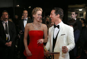 "Photo - FILE - In this March 2, 2014 file photo, Jennifer Lawrence, left, and Matthew McConaughey appear backstage during the Oscars at the Dolby Theatre in Los Angeles.   Oscar winner ""12 Years a Slave"" will face off with blockbusters like ""The Hunger Games: Catching Fire"" and ""The Hobbit: The Desolation of Smaug"" at the MTV Movie Awards. The network announced Thursday, March 6, 2014,  the nominees for its 24th annual Movie Awards. The other movie-of-the-year nominees are ""The Wolf of Wall Street"" and ""American Hustle."" Most of the best male and female nominees reassemble recent Oscar contenders like Matthew McConaughey, Lupita Nyong'o and Leonardo DiCaprio. (Photo by Matt Sayles/Invision/AP)"