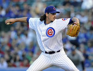 Photo - Chicago Cubs' Jeff Samardzija pitches against the Milwaukee Brewers during the first inning of a baseball game, Monday, July 29, 2013, in Chicago. (AP Photo/Jim Prisching)