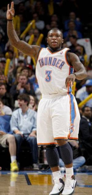 Photo - REACTION: Oklahoma City's Nate Robinson (3) reacts after a basket during the NBA basketball game between the Oklahoma City Thunder and the Indiana Pacers at the Oklahoma City Arena, Wednesday, March 2, 2011. Photo by Bryan Terry, The Oklahoman <strong>BRYAN TERRY</strong>