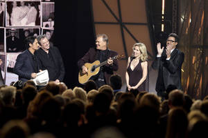 Photo - From left, Brad Paisley, Jimmy Webb, Glen Campbell, Glen's wife Kim, and Vince Gill, are seen onstage during a tribute to Glen Campbell at the 45th Annual CMA Awards in Nashville, Tenn., on Wednesday, Nov. 9, 2011. (AP Photo/Mark Humphrey) ORG XMIT: CASH288