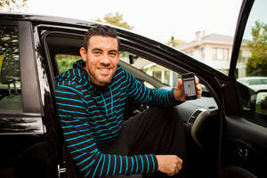 Photo - Nick Collison with the Oklahoma City Thunder used the Uber application on his smart phone to call for a ride through the new transportation service that just arrived here last week. PHOTO PROVIDED. <strong></strong>