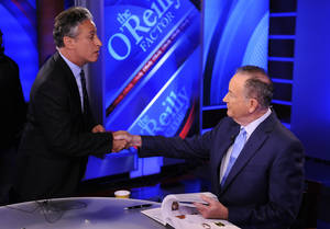"Photo -   FILE - In this Sept. 22, 2010 file photo, Comedy Central's Jon Stewart, left, and Bill O'Reilly tape an interview in New York. Stewart and O'Reilly, a celebrity odd couple with a history of public political feuds, tangle in a sold-out debate in Washington. The so-called ""Rumble in the Air-Conditioned Auditorium"" offers a jocular sideshow to the series of three more somber debates this month between President Barack Obama and Republican Mitt Romney. (AP Photo/Peter Kramer)"