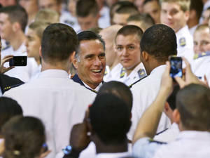 Photo -   Republican presidential candidate, former Massachusetts Gov. Mitt Romney greets cadets after delivering a foreign policy speech at Virginia Military Institute (VMI) in Lexington, Va., Monday, Oct. 8, 2012. (AP Photo/Charles Dharapak)