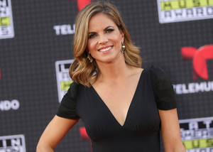 In this Oct. 8, 2015, file photo, Natalie Morales arrives at the Latin American Music Awards at the Dolby Theatre in Los Angeles. NBC Today show anchor Morales is moving West to become host of the entertainment show Access Hollywood, but will keep a role on the morning program. NBC said Wednesday, May 4, 2016, that it hasn't been determined whether she will continue to host the third hour from California or if that role will go to someone else. (Photo by Paul A. Hebert/Invision/AP, File)