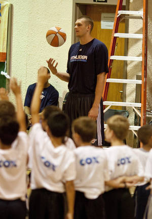 Photo - Camp participants ask Cole Aldrich questions. Cole Aldrich of the Oklahoma City Thunder helped at the Thunder Basketball Camp in Norman, Okla on Thursday June 22, 2010. Photo by Mitchell Alcala, The Oklahoman