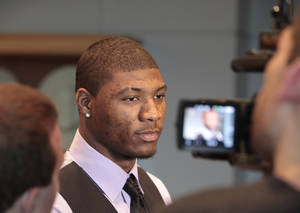 Photo - Marcus Smart speaks with the media at the Devon Energy College Basketball Awards banquet at the National Cowboy & Western Heritage Museum in Oklahoma City, Monday, April 15, 2013. Photo By David McDaniel/The Oklahoman