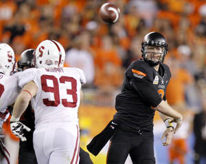 Photo - COLLEGE FOOTBALL: Oklahoma State's Brandon Weeden (3) throws a pass during the Fiesta Bowl between the Oklahoma State University Cowboys (OSU) and the Stanford Cardinals at the University of Phoenix Stadium in Glendale, Ariz., Monday, Jan. 2, 2012. Photo by Bryan Terry, The Oklahoman