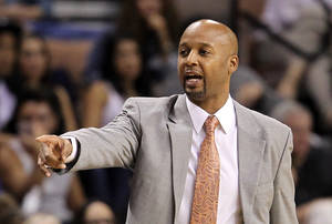 Photo - Denver Nuggets head coach Brian Shaw instructs his team during the first half of a preseason NBA basketball game against the Los Angeles Clippers on Saturday, Oct. 19, 2013, in Las Vegas. The Clippers defeated the Nuggets in overtime 118-111. (AP Photo/Isaac Brekken)