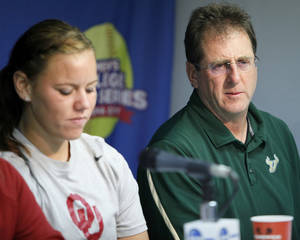 Photo - COLLEGE SOFTBALL / MUG: University of South Florida head coach Ken Eriksen speaks next to Oklahoma's Keilani Ricketts during media day for the Women's College World Series at ASA Hall of Fame Stadium in Oklahoma City, Wednesday, May 30, 2012.  Photo by Nate Billings, The Oklahoman