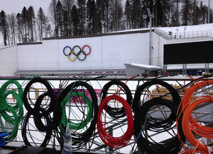 Photo - Cabling is coiled along a railing before being installed at the Laura Biathlon Center in preparation for the 2014 Winter Olympics in the Olympic Park, Monday, Jan. 27, 2014, in Krasnaya Polyana, Russia. (AP Photo/Tony Hicks)