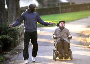 "Photo - Omar Sy and Francois Cluzet star in ""The Intouchables."" <strong></strong>"
