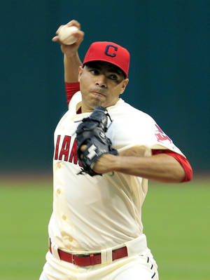 Photo -   Cleveland Indians starting pitcher Jeanmar Gomez throws in the first inning of a baseball game against the Texas Rangers, Saturday, Sept. 1, 2012, in Cleveland. (AP Photo/Tony Dejak)