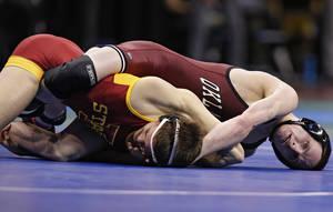 Photo - Oklahoma's Nick Lester battles Iowa State's Gabe Moreno in the 141 pound match during the 2014 NCAA Div. 1 Wrestling Championships at Chesapeake Energy Arena in Oklahoma City, Okla. on Thursday, March 20, 2014. Photo by Chris Landsberger, The Oklahoman