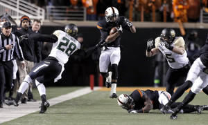 Photo - Oklahoma State's Josh Stewart (5) tries to get by Baylor's Orion Stewart (28) and Baylor's Eddie Lackey (5) during a college football game between the Oklahoma State University Cowboys (OSU) and the Baylor University Bears (BU) at Boone Pickens Stadium in Stillwater, Okla., Saturday, Nov. 23, 2013. Photo by Sarah Phipps, The Oklahoman