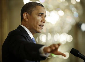 Photo - President Barack Obama gestures as he answers questions from members of the media during a news conference in the East Room of the White House in Washington, Monday, Jan. 14, 2013.  (AP Photo/Pablo Martinez Monsivais)