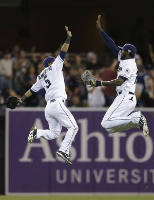 Photo -   San Diego Padres second baseman Alexi Amarista, left, and center fielder Cameron Maybin, right, celebrate after beating the St. Louis Cardinals during their baseball game Tuesday, Sept. 11, 2012, in San Diego. The Padres won, 6-4. (AP Photo/Gregory Bull)