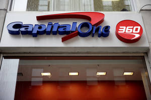 Photo - FILE - In this Jan. 14, 2014, file photo, a Capital One sign is displayed in Philadelphia. Capital One Financial Corp. reports quarterly financial results after the market close on Thursday, Jan. 16, 2014. (AP Photo/Matt Rourke, File)