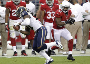 Photo -   St. Louis Rams cornerback Janoris Jenkins (21) intercepts a pass intended for Arizona Cardinals running back LaRod Stephens-Howling (36) during the first half of an NFL football game, Sunday, Nov. 25, 2012, in Glendale, Ariz. (AP Photo/Ross D. Franklin)