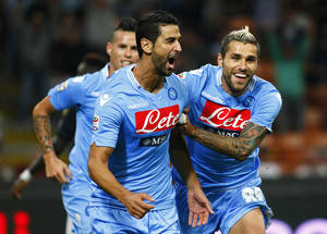 Photo - Napoli Uruguayan defender Miguel Britos, left, celebrates with his Swiss teammate Valon Beharmi after scoring, during the Serie A soccer match between AC Milan and Napoli at the San Siro stadium in Milan, Italy, Sunday, Sept. 22, 2013. (AP Photo/Spada, Lapresse)