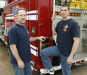 Photo - Edmond firefighters Tim Vernon, left, and John Werhun stop by Fire Station 1 to pose for a photo in 2009. PHOTO BY PAUL HELLSTERN, THE OKLAHOMAN archives