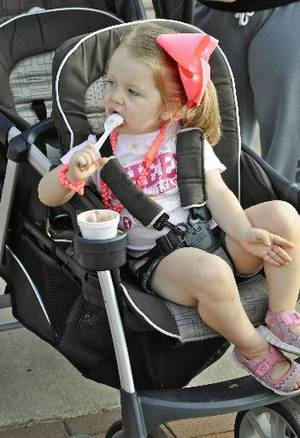 Photo - Emma Ogle enjoys a frozen treat during Taste of Edmond, one of 10 LibertyFest events that celebrate Independence Day. The celebration ends with a parade and fireworks display in Edmond on Thursday. PHOTO BY M. TIM BLAKE, FOR THE OKLAHOMAN. <strong>M. TIM BLAKE - FOR THE OKLAHOMAN</strong>