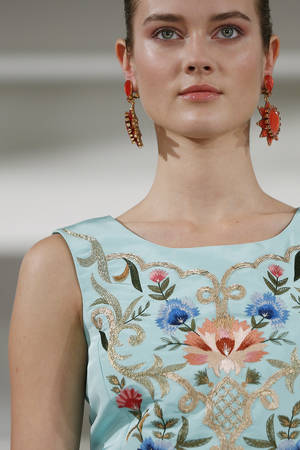 Photo - The Oscar de la Renta Spring 2014 collection is modeled during Fashion Week in New York, Tuesday, Sept. 10, 2013. (AP Photo/John Minchillo) ORG XMIT: NYJM229