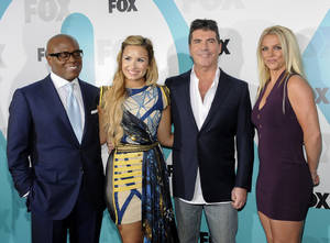 "Photo -   ""The X Factor"" judges, from left, L.A. Reid, Demi Lovato, Simon Cowell and Britney Spears attend the FOX network upfront presentation party at Wollman Rink, Monday, May 14, 2012 in New York. (AP Photo/Evan Agostini)"