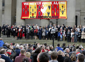 Photo -   People gather at St George's Place to attend a vigil in memory of the 96 victims of the Hillsborough stadium disaster in Liverpool, England, Sept. 12, 2012. British police and medics whose failures contributed to the deaths of 96 soccer fans in the country's worst sports disaster unfairly blamed the dead for the 1989 tragedy and sought to cover up their actions, newly disclosed documents revealed Wednesday. (AP Photo/PA, Peter Byrne) UNITED KINGDOM OUT, NO SALES, NO ARCHIVE