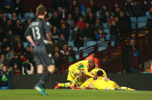Photo - Sheffield United players celebrate Ryan Flynn's goal during their FA Cup third round soccer match against Aston Villa at Villa Park, Birmingham, England, Saturday, Jan. 4, 2014. (AP Photo/David Davies, PA Wire)   UNITED KINGDOM OUT  -  NO SALES  -  NO ARCHIVES