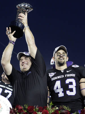 photo - TCU coach Gary Patterson, left, celebrates with linebacker Tank Carder after the Horned Frogs beat Wisconsin to win the Rose Bowl. AP PHOTO