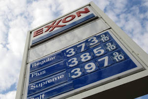 Photo - FILE - This Feb. 27, 2012, file photo shows gas prices at a Pittsburgh Exxon mini-mart. Exxon Mobil Corp. reports quarterly financial results before the market open on Thursday, Oct. 31, 2013. (AP Photo/Gene J. Puskar, File)