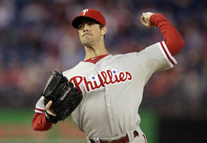 Photo - FILE - In this Sept. 14, 2013, file photo, Philadelphia Phillies starting pitcher Cole Hamels delivers against the Washington Nationals during the first inning of a baseball game at Nationals Park in Washington. Hamels said he will not throw off the mound for at least another week after suffering from fatigue following his latest throwing session. (AP Photo/Pablo Martinez Monsivais, File)