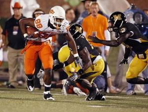 Photo - Jamal  Mosley (88) runs after a catch in the first half as Oklahoma State University Cowboys (OSU) plays the University of Missouri Tigers (MIZZOU) at Faurot Field in Columbia, Mo. on Saturday October 11, 2008. BY STEVE SISNEY
