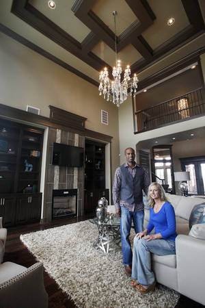 photo - Homebuilders Kenyon and Brandi Woods, co-owners of Authentic Custom Homes, show the living room of one of their entires in the Parade of Homes, at 3208 NW 176 Place in the Rose Creek neighborhood near NW 164 and May Avenue. Photo by Paul B. Southerland, The Oklahoman <strong>PAUL B. SOUTHERLAND</strong>