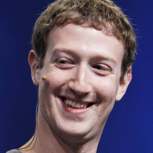 Photo - FILE - In this Sept. 22, 2011 file photo, Facebook CEO Mark Zuckerberg smiles during the f/8 conference in San Francisco. As Facebook promotes the vision of its 28-year-old CEO as part of this week's first-ever sale of stock to the public, one of the most striking features of his persona is the contradiction between the public and private that remains at its center. Zuckerberg avoids questions about himself and once sued a magazine for publishing documents revealing details from his past.  (AP Photo/Paul Sakuma, File) ORG XMIT: NY107