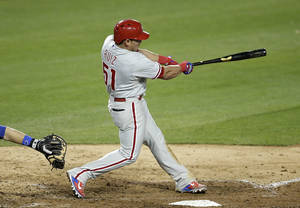 Photo - Philadelphia Phillies' Carlos Ruiz hits a two-run double during the ninth inning of a baseball game against the Los Angeles Dodgers on Thursday, April 24, 2014, in Los Angeles. (AP Photo/Jae C. Hong)