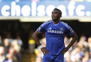 Photo - FILE - A Saturday, April 19, 2014 photo from files showing Chelsea's Samuel Eto'o reacting to a decision by the referee Mike Dean, during an English Premier League soccer match against Sunderland at the Stamford Bridge ground in London. Everton strengthened its attacking options by signing Samuel Eto'o on a two-year deal on Tuesday, Aug. 26, 2014, after the striker was released by Premier League rival Chelsea. The 33-year-old Cameroon international, who scored 12 goals in 35 matches in his only season at Chelsea, is available to make his debut against the west London club on Saturday.  (AP Photo/Lefteris Pitarakis, File)