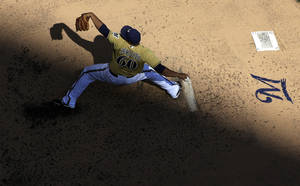 Photo - Milwaukee Brewers starting pitcher Wily Peralta throws during the fourth inning of an MLB National League baseball game against the Cincinnati Reds Sunday, Aug. 18, 2013, in Milwaukee. (AP Photo/Morry Gash)