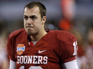 Photo - REACTION: Oklahoma's Landry Jones reacts during the Cotton Bowl college football game between the University of Oklahoma (OU)and Texas A&M University at Cowboys Stadium in Arlington, Texas, Friday, Jan. 4, 2013. Oklahoma lost 41-13. Photo by Bryan Terry, The Oklahoman