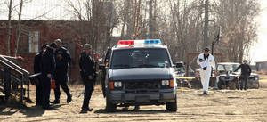 "Photo - Investigators work at the scene of the fatal shooting of Alaska State Trooper Sergeant Patrick ""Scott"" Johnson and Trooper Gabriel ""Gabe"" Rich Friday, May 2, 2014, in the village of Tanana, Alaska. Two men have been taken into custody for the shooting deaths of the troopers. The troopers had gone to Tanana to follow up on a report Wednesday night that someone had brandished a firearm in the village. The two troopers were occasionally featured on the National Geographic Channel show ""Alaska State Troopers,"" which features multiple troopers patrolling the state's wild terrain. The troopers were not filming at the time of their deaths. (AP Photo/Fairbanks Daily News-Miner, Eric Engman)"