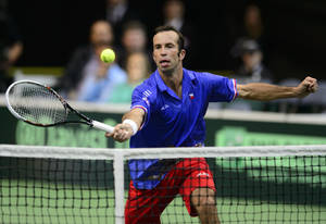 Photo - Czech Radek Stepanek returns the ball towards Argentina´s Juan Monaco during the Czech Republic - Argentina Davis Cup semifinal tennis match in Prague, Czech Republic, Friday, Sept. 13, 2013. (AP Photo/CTK, Michal Kamaryt) SLOVAKIA OUT