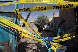 Photo -   The destroyed entrance of the house where a Syrian mortar attack killed five people in Akcakale, Turkey, Thursday, Oct. 4, 2012. Turkey fired on Syrian targets for a second day Thursday, but said it has no intention of declaring war, despite tensions after deadly shelling from Syria killed five civilians in a Turkish border town.(AP Photo)