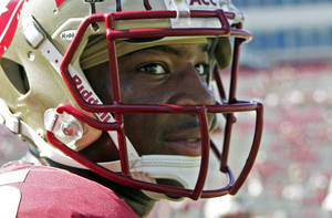 Photo - FILE - In this Oct. 5, 2013, file photo, Florida State's Jameis Winston looks around during warms ups prior to an NCAA college football game against Maryland in Tallahassee, Fla. Winston envisioned winning the Heisman Trophy before signing with the top-ranked Seminoles. He is one of six finalists for the award and will find out Saturday if his dream comes true. (AP Photo/Steve Cannon, File)