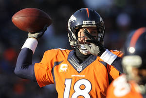 Photo - Denver Broncos quarterback Peyton Manning throws against the Tennessee Titans during the first half of an NFL football game on Sunday, Dec. 8, 2013, in Denver. (AP Photo/Chris Schneider)