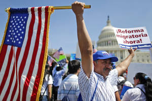 Photo - Rigoberto Ramos from Seaford, Del., originally from Guatemala, rallies for immigration reform in front of the U.S. Capitol in Washington, Wednesday, April 10, 2013. (AP Photo/Charles Dharapak)