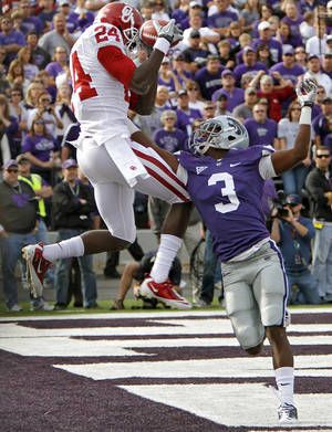 Photo - Oklahoma Sooners' Dejuan Miller (24) catches a touchdown over Kansas State Wildcats' Allen Chapman (3) during the college football game between the University of Oklahoma Sooners (OU) and the Kansas State University Wildcats (KSU) at Bill Snyder Family Stadium on Sunday, Oct. 30, 2011. in Manhattan, Kan. Photo by Chris Landsberger, The Oklahoman  ORG XMIT: KOD