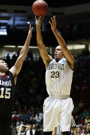 photo -   FILE - This March 15, 2012 file photo shows Vanderbilt guard John Jenkins shooting over Harvard guard Christian Webster (15) during the first half of an NCAA tournament second-round college basketball game in Albuquerque, N.M. Jenkins is a possible pick in the NBA Draft on June 28. (AP Photo/Jake Schoellkopf, File)